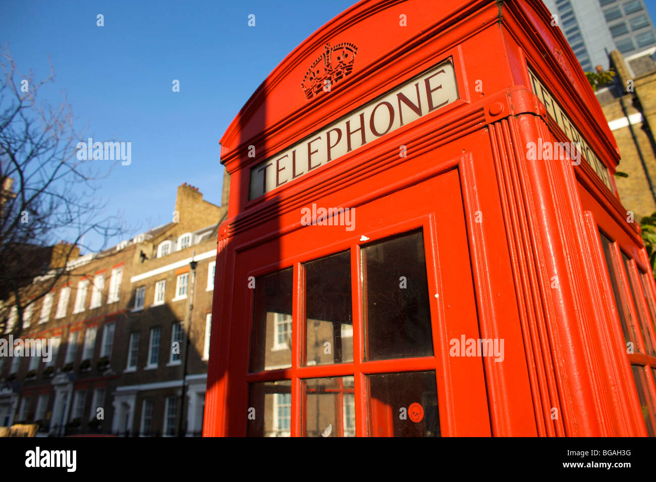 Old fashioned K1 red telephone boxes designed by Sir Gilbert Scott in London UK - Stock Image
