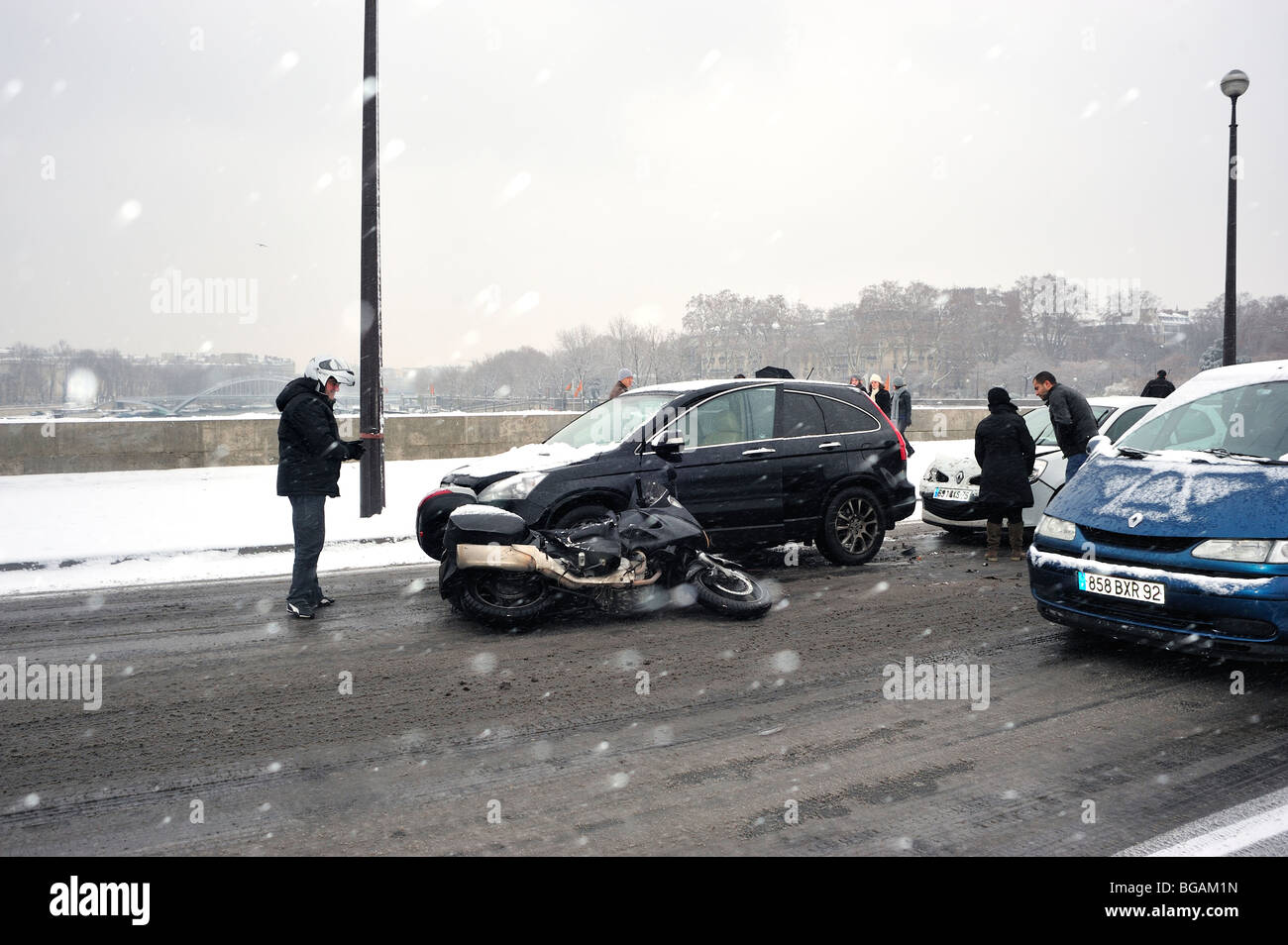 paris france automobile and motorcycle car accident during winter