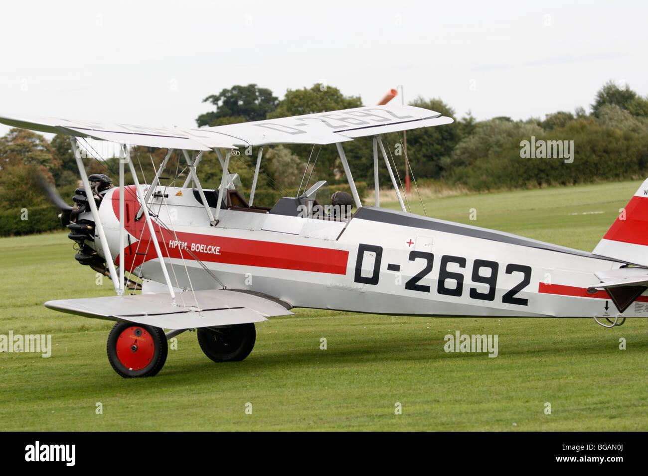 Focke-Wulf Fw.44J Stieglitz, G-STIG / D-2692. Goldfinch. Two seat trainer biplane. Siemens-Halske Sh 14 radial engine - Stock Image