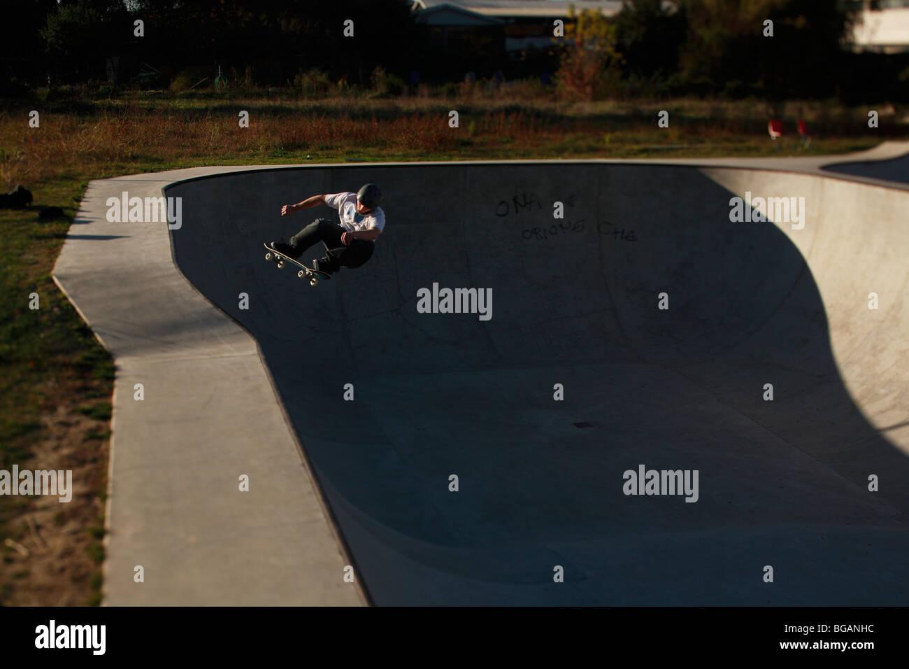 Skateboarder Peter Dossett does a frontside smith grind at Dreamlands skatepark - Stock Image