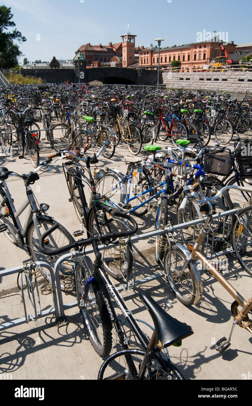 bikes cycles parked outside malmo train station sweden swedish Scandinavian Scandinavia commuters commuting railway - Stock Image
