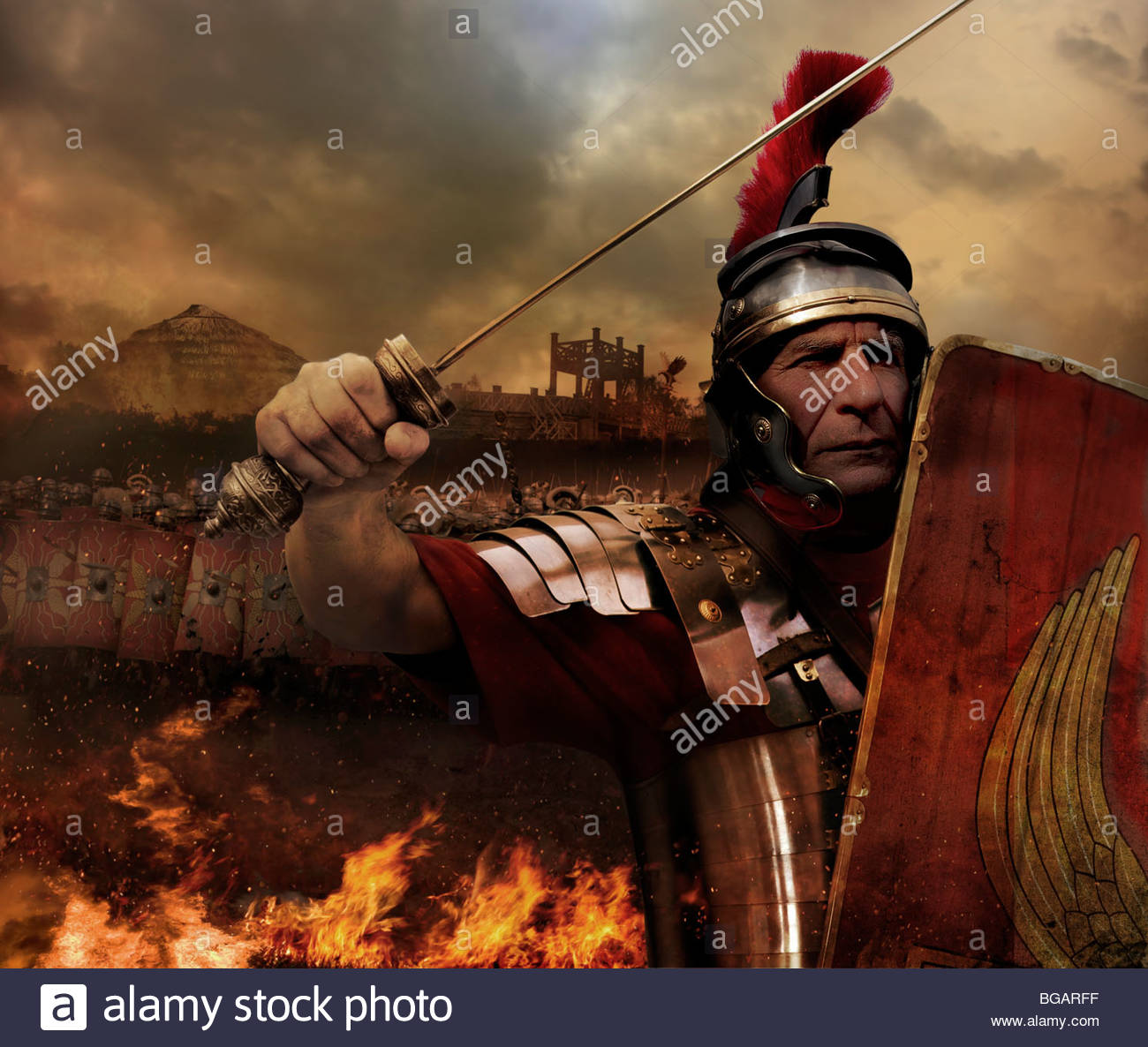 a mean looking roman soldier charging into battle stock photo