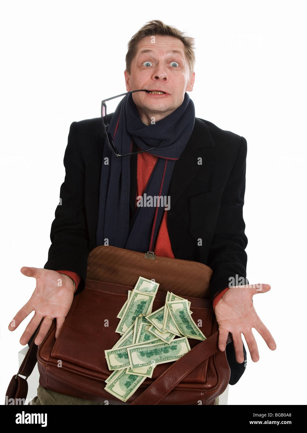 Tricky and greedy man with lots of cash on a white background - Stock Image