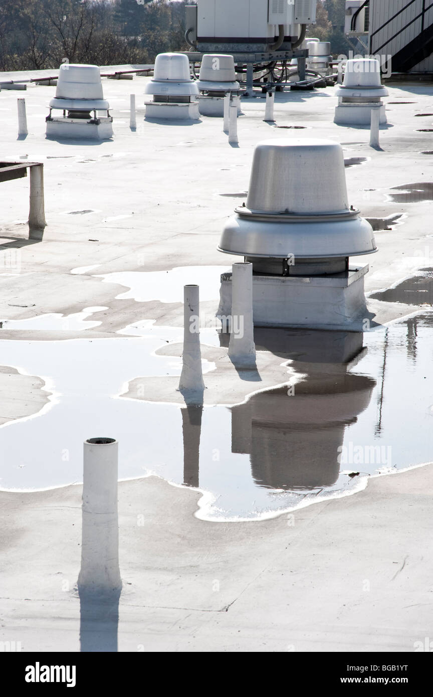 Heating Vents & Puddles On Flat Commercial Roof, Philadelphia USA - Stock Image