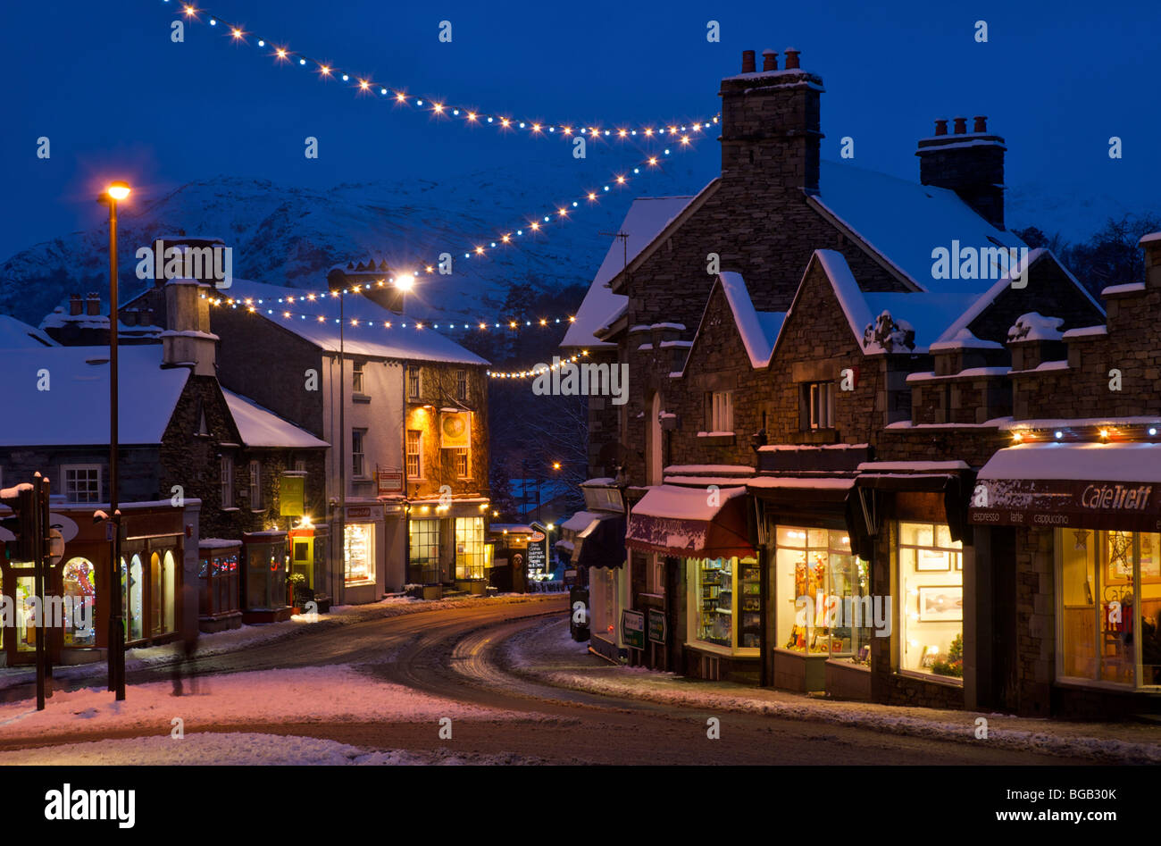 Ambleside at night, overlooked by Loughrigg Fell, Lake District National Park, Cumbria, England UK - Stock Image