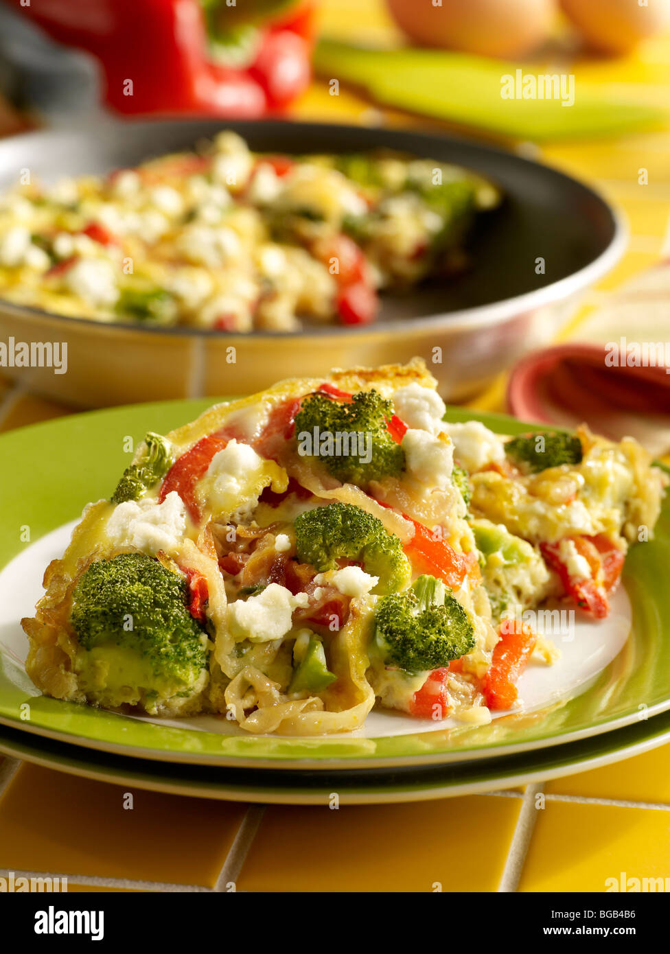 Caramelized onion, red pepper and broccoli frittata - Stock Image