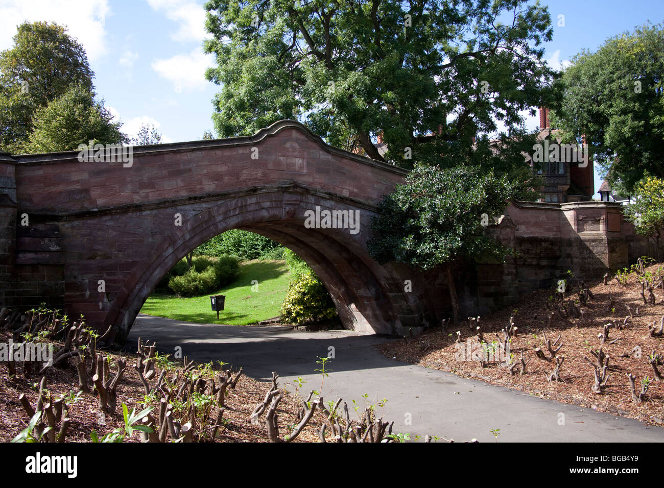 Port Sunlight, home of Lever Brothers later to become Unilever. The bridge once stood over a river - Stock Image