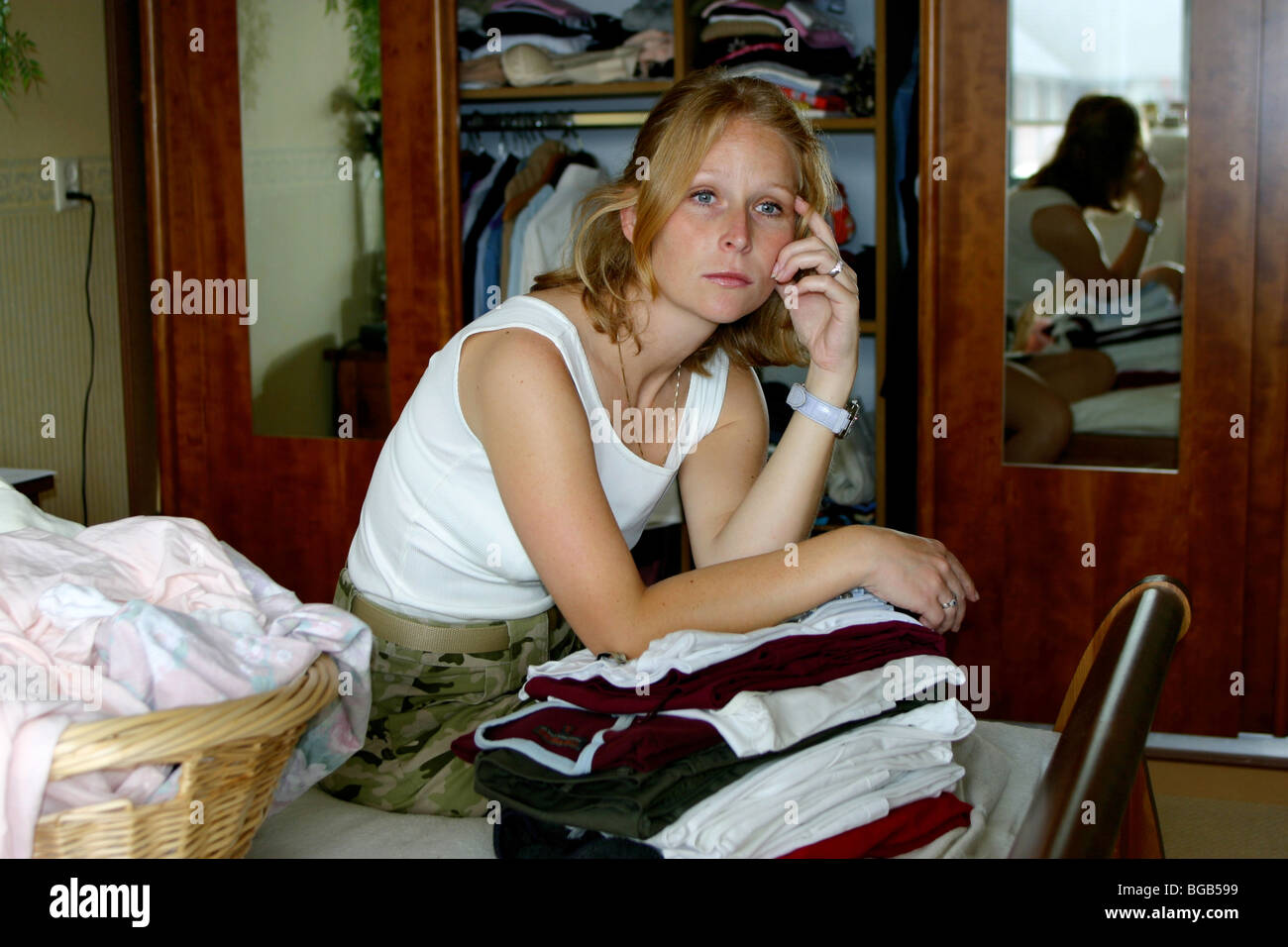 Frustrated housewife - woman sad one person only indoors - Stock Image