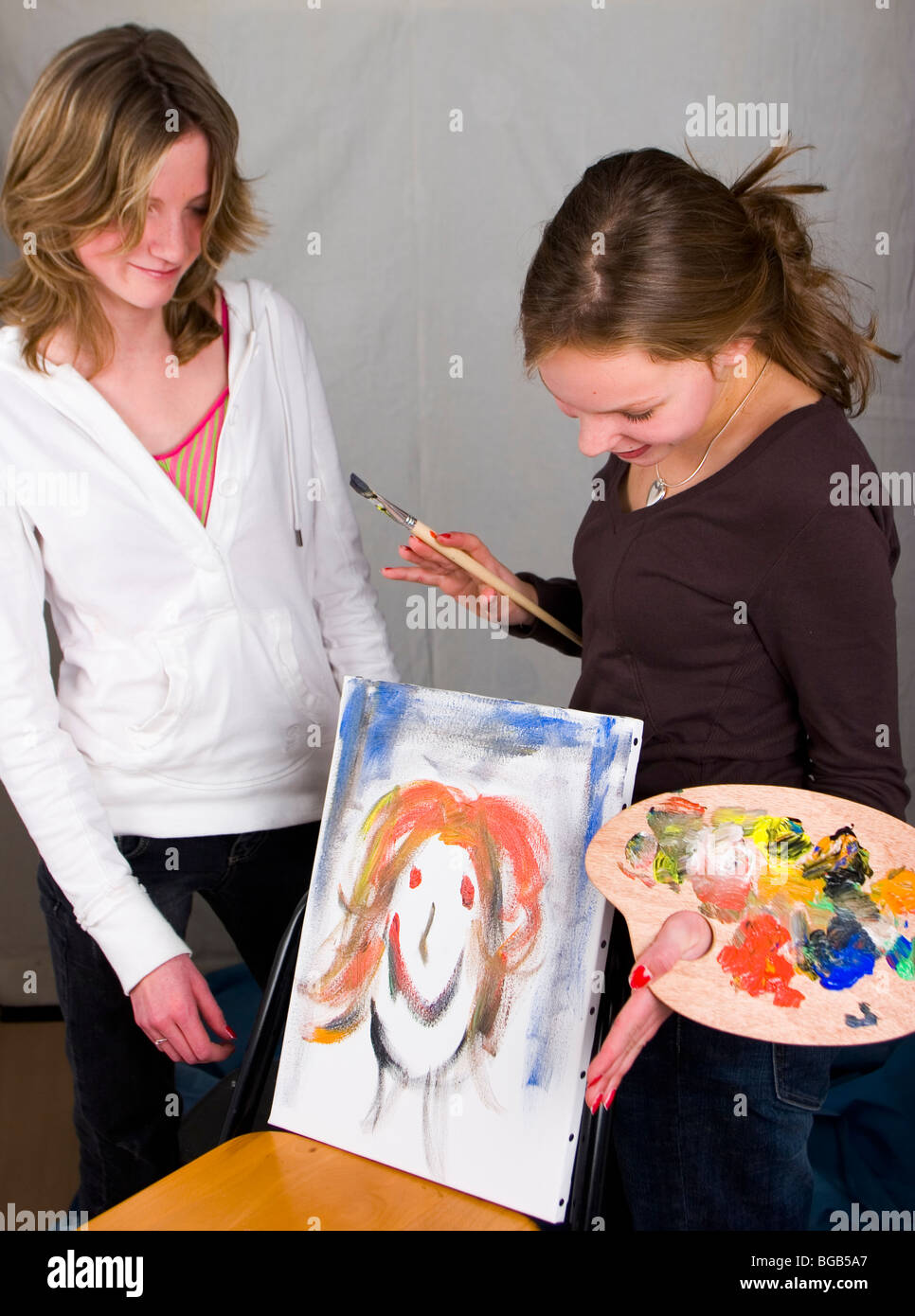Teenager painting portrait from friend - SerieCVS317704b - Stock Image