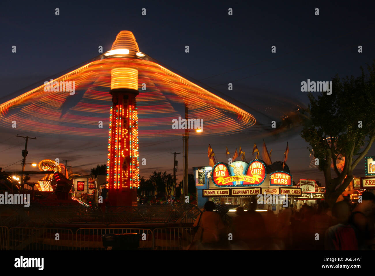 Carnival Rides at Dusk. Canfield Fair. Mahoning County Fair. Canfield, Ohio. - Stock Image