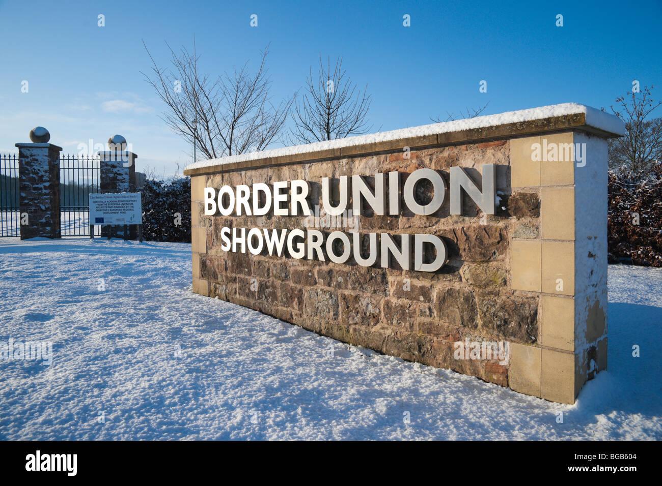 December snow scene Kelso Scottish Borders UK - Border Union showground sign entrance to Springwood Park - Stock Image