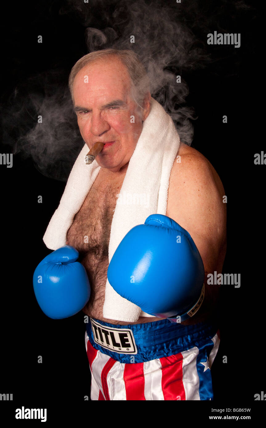 04f5b4171833 spoof of aging boxer on black background smoking cigar with white towel  around neck. Blue gloves and american flag trunks