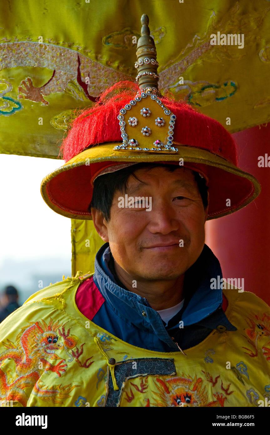 Man wearing traditional Imperial era costume Beijing China - Stock Image
