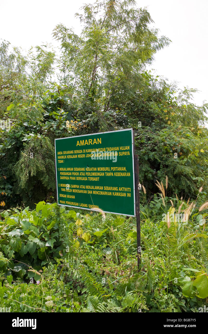 Forested watershed area with protection sign in Malay, the Sindora Palm Oil Plantation Stock Photo