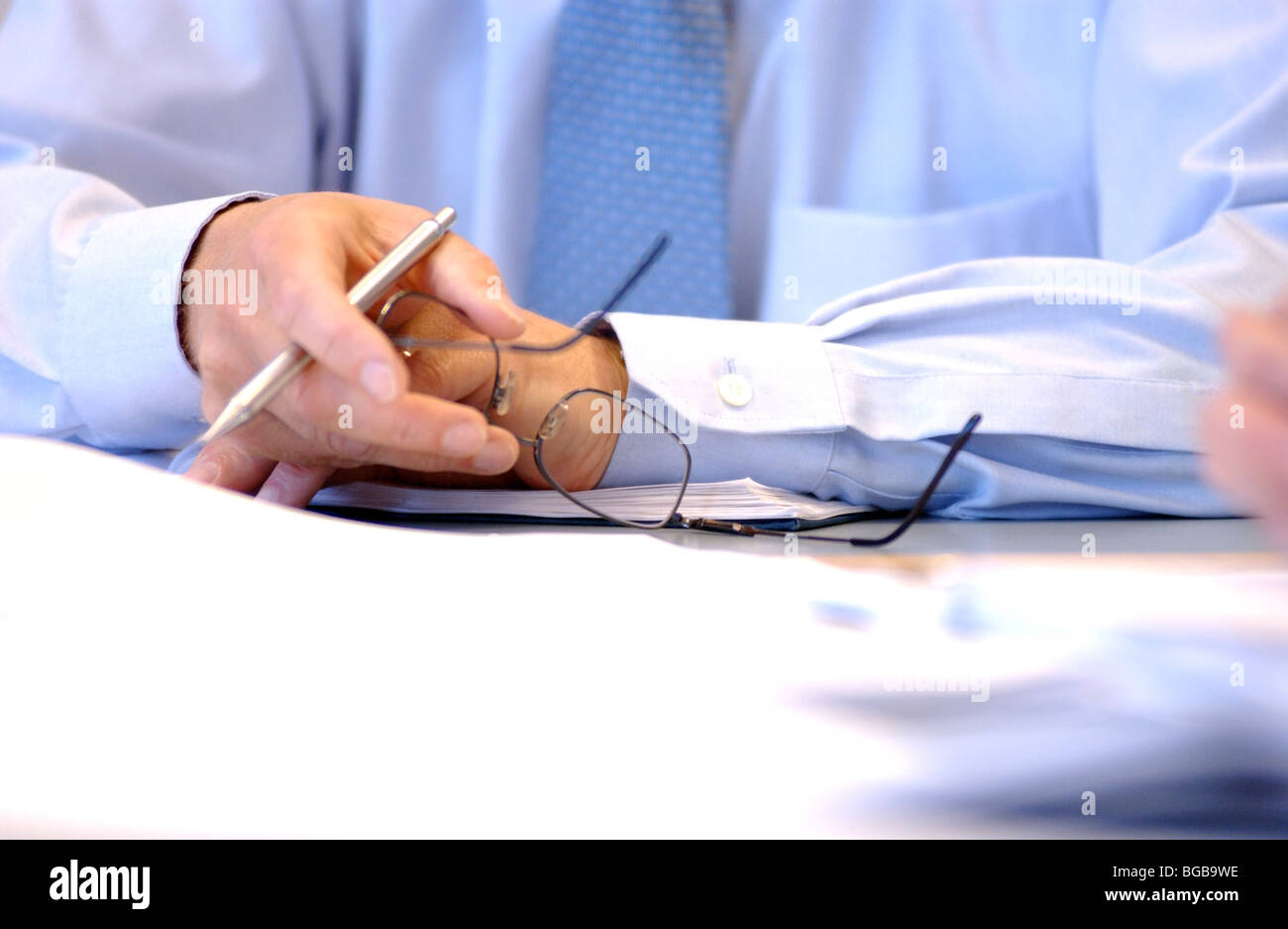 Royalty free photograph of business meeting with papers and hands in focus London UK Stock Photo