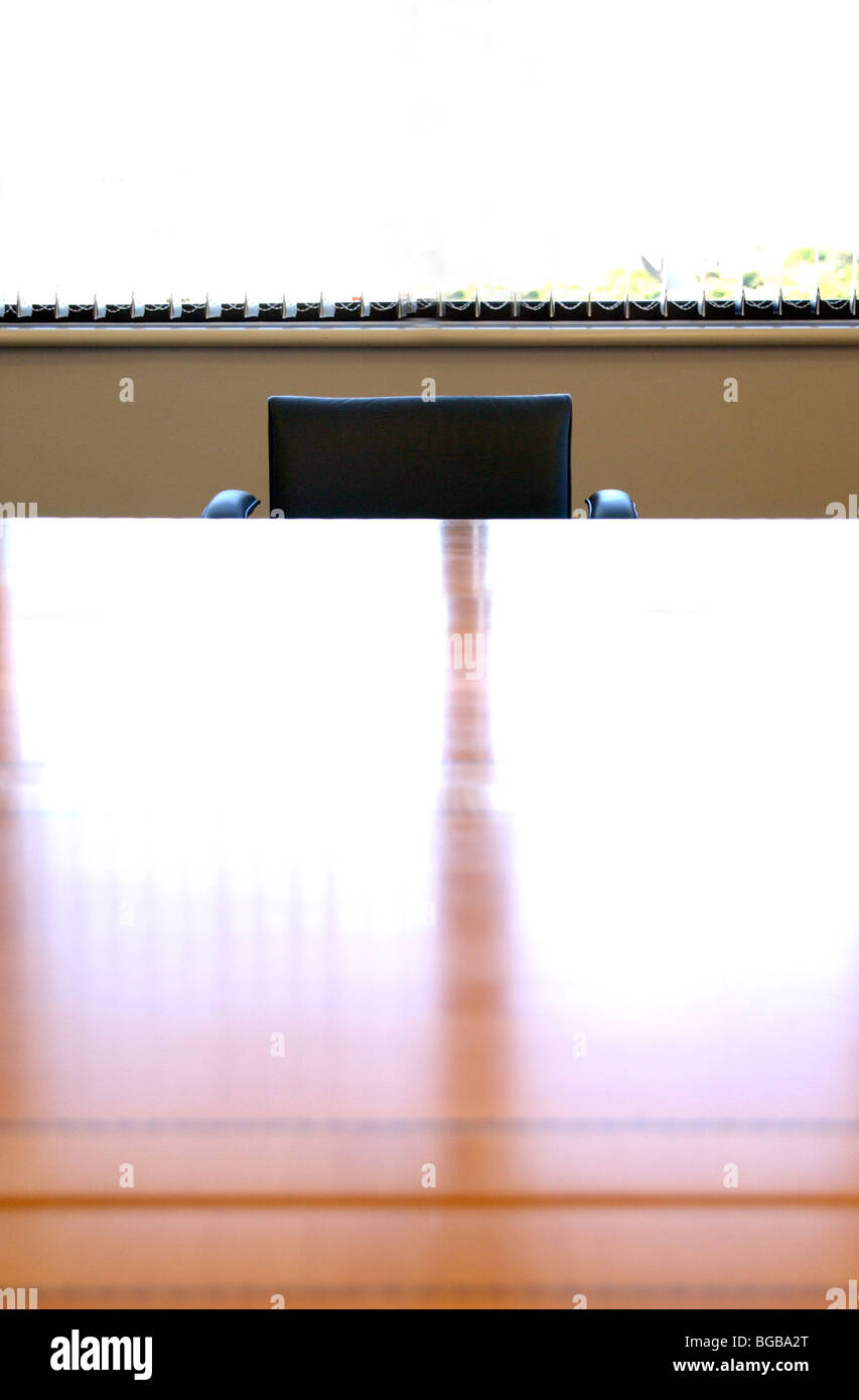 Royalty free photograph of interview table hot seat intimidating job empty UK - Stock Image