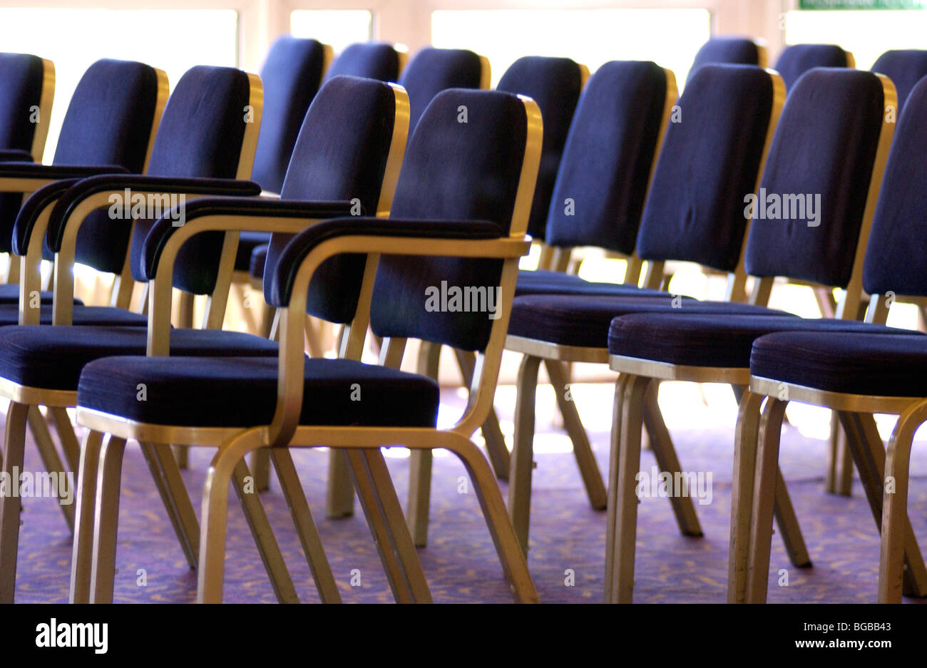 Photograph of rows seating wedding guests empty venue conference - Stock Image