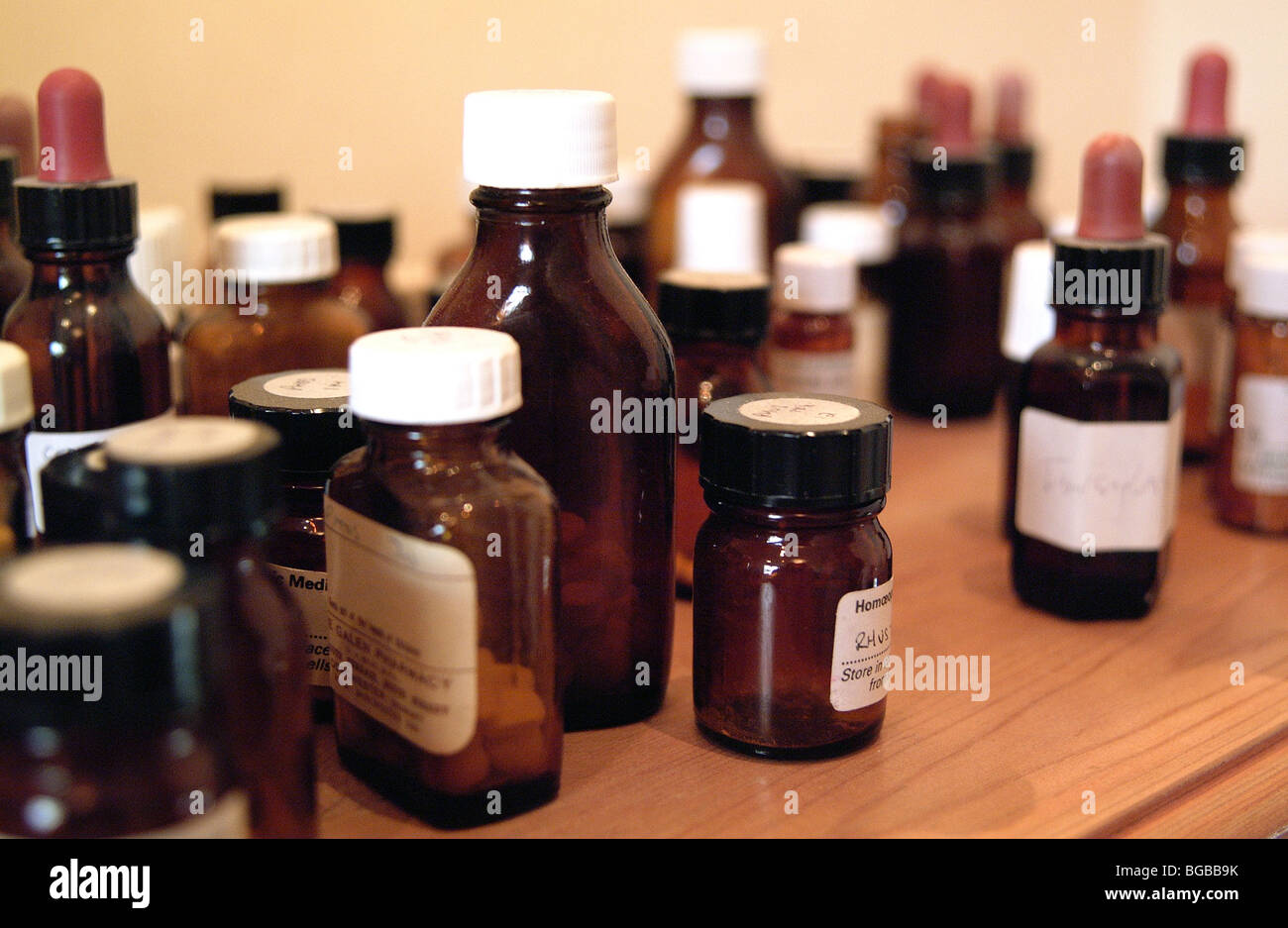 Royalty free photograph of bottles pills medicine cabinet health issues - Stock Image
