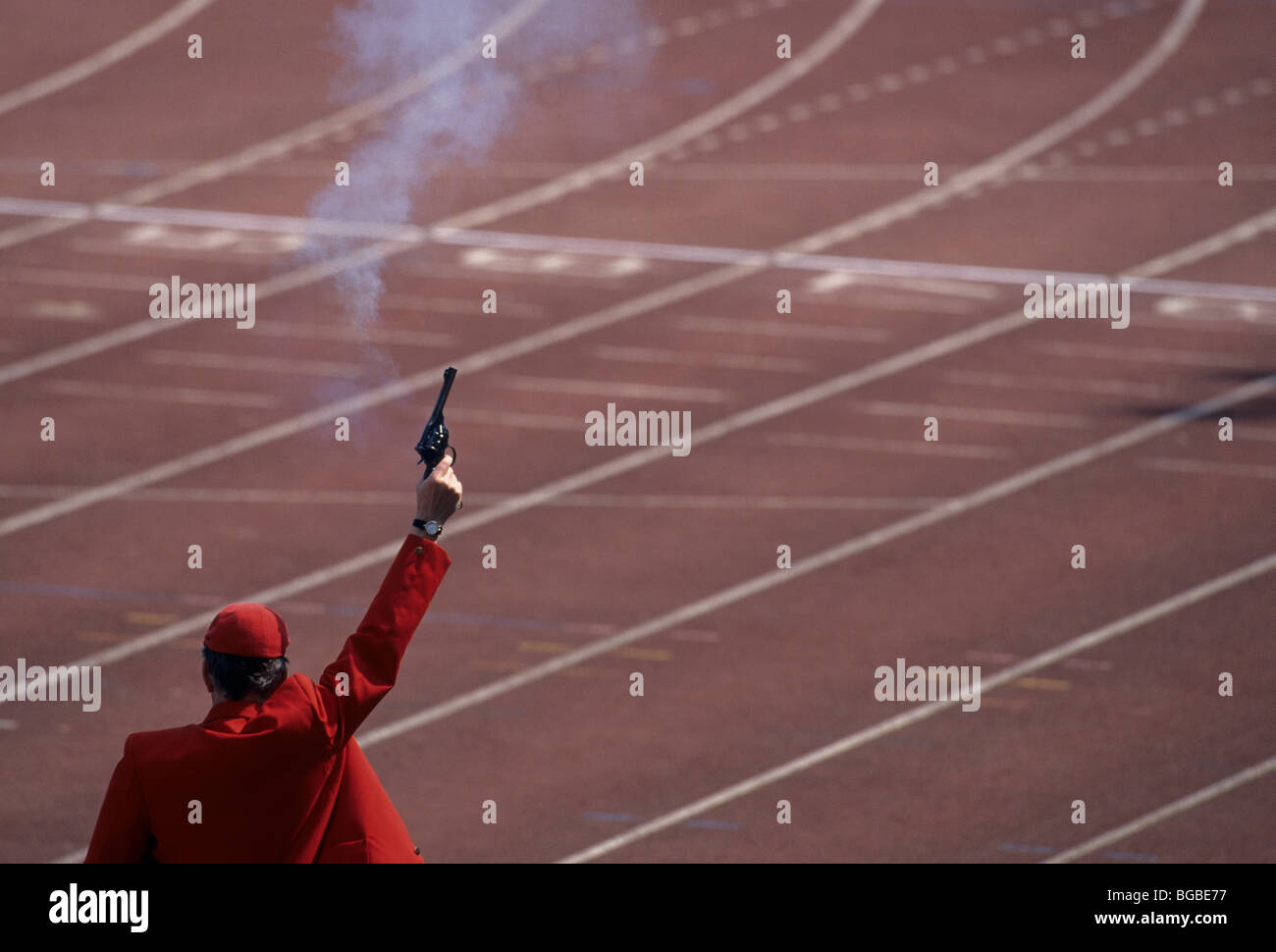 Official firing a starting gun on a track Stock Photo: 27297515 - Alamy