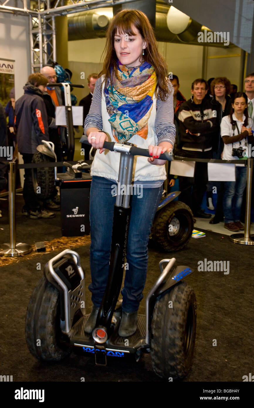 Young lady driving the Segway two-wheeled vehicle - Stock Image