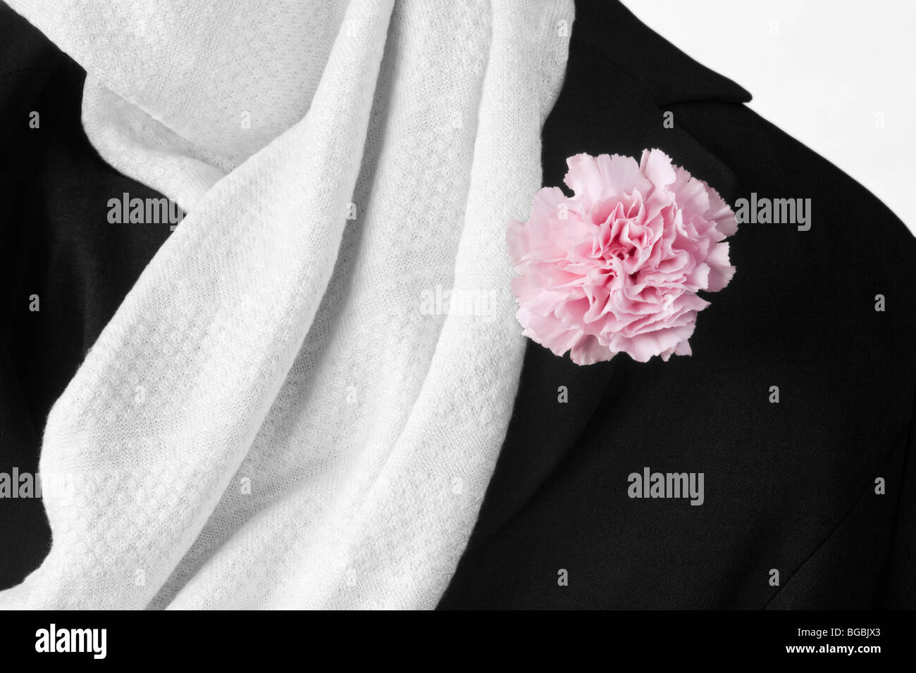 Close up of white silk scarf and black jacket - Stock Image