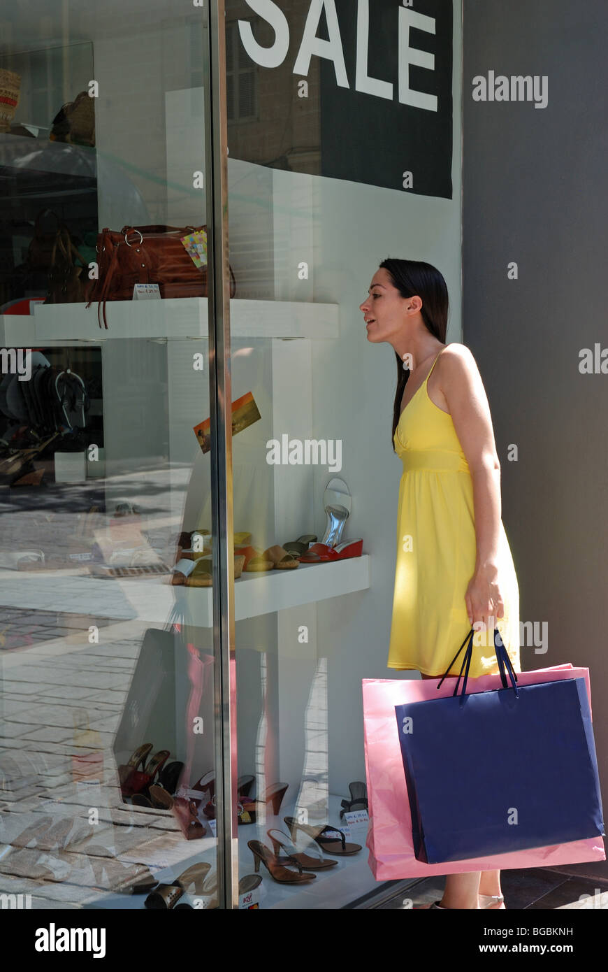young woman on a shopping spree - Stock Image