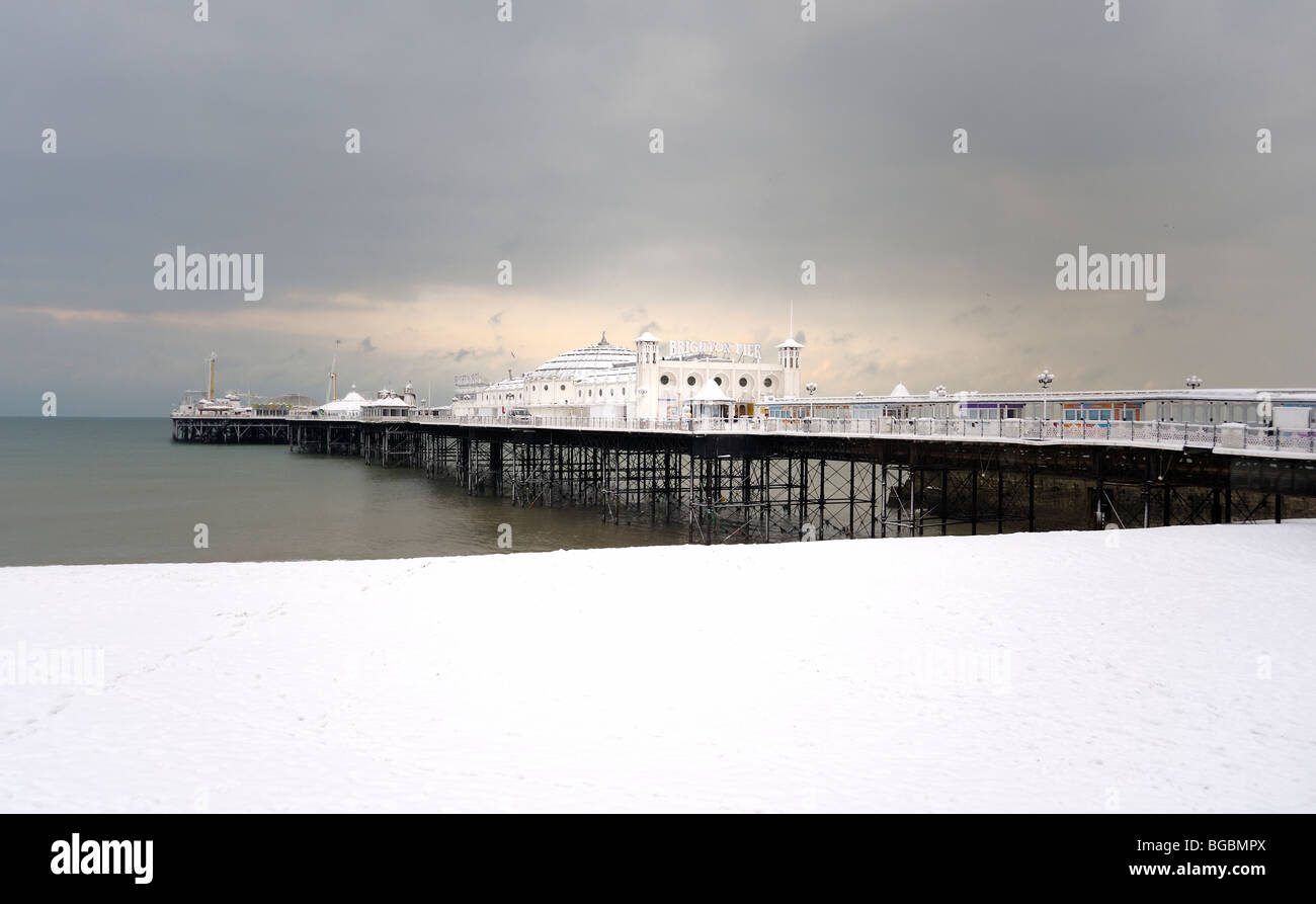 Brighton pier and beach covered in snow Stock Photo