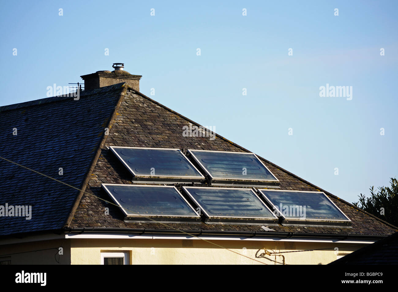 solar panels in the roof of a house in bristol, england, uk - Stock Image