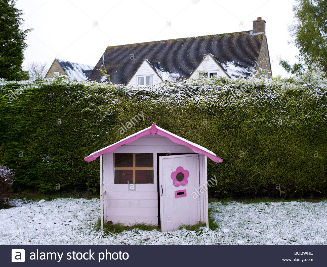 Wendy house in the snow Stock Photo