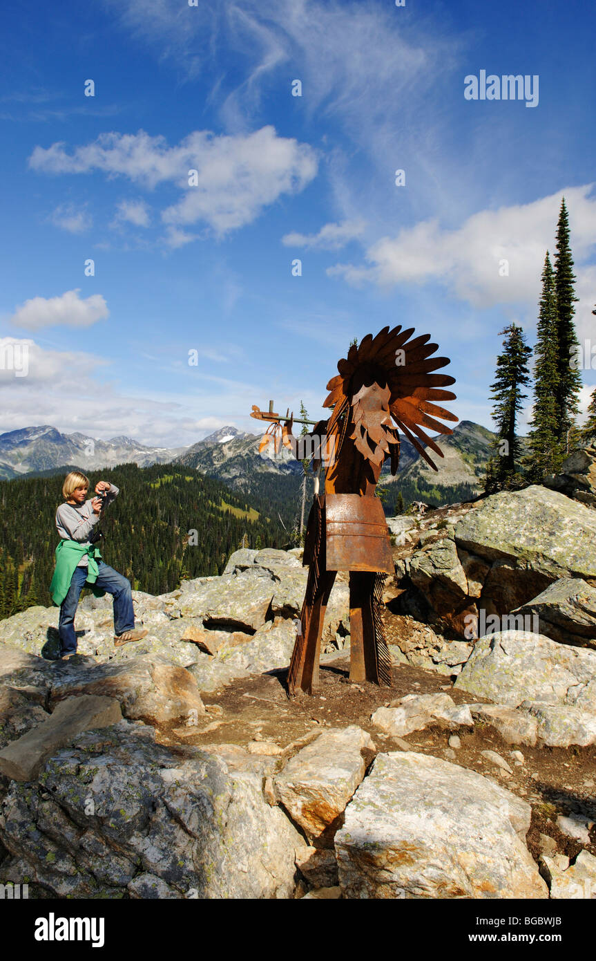 Child photographing a Native American iron chief, Mt. Revelstoke, Meadows in the Sky, Revelstoke National Park, - Stock Image