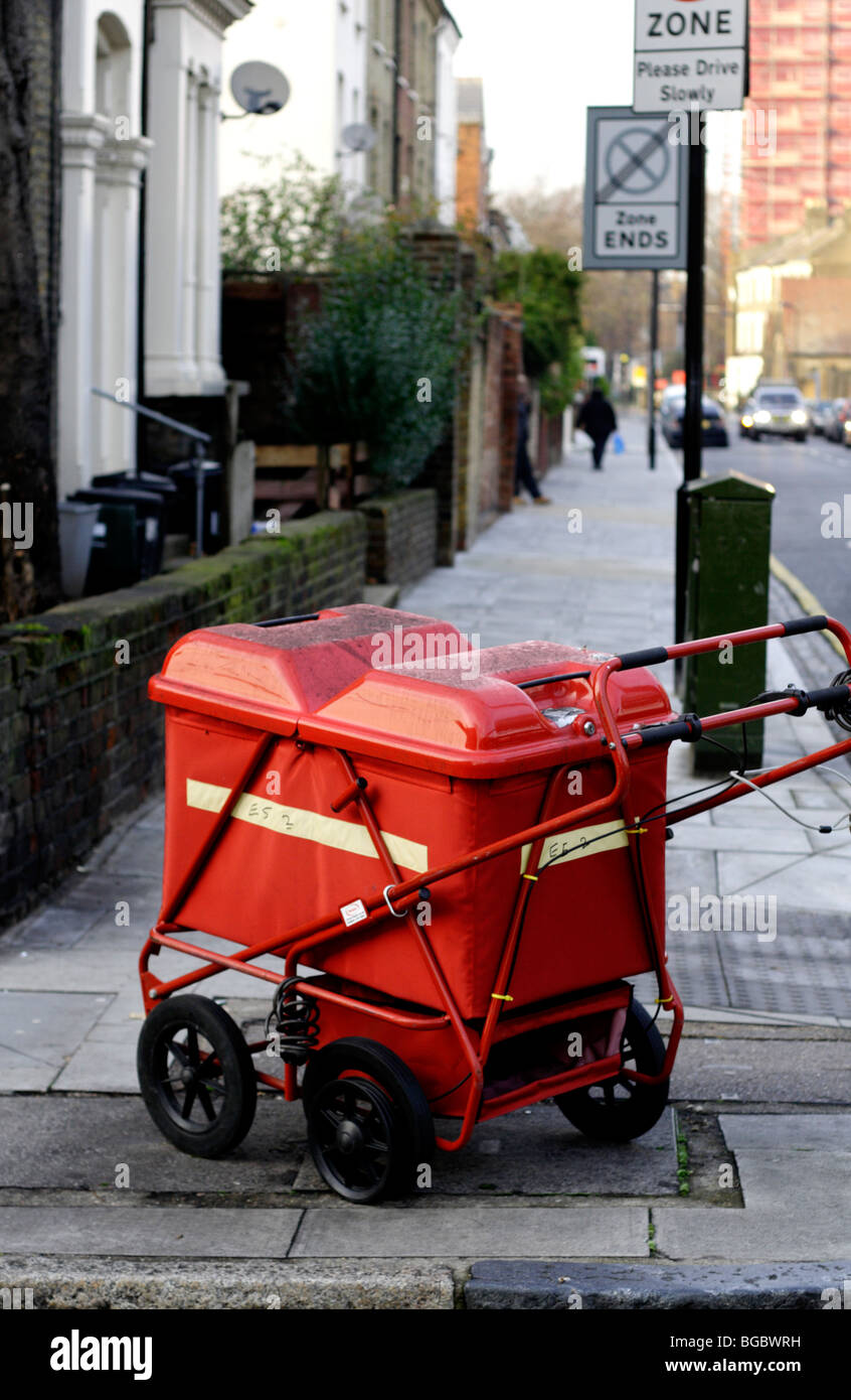 postmen's trolley left on street - Stock Image
