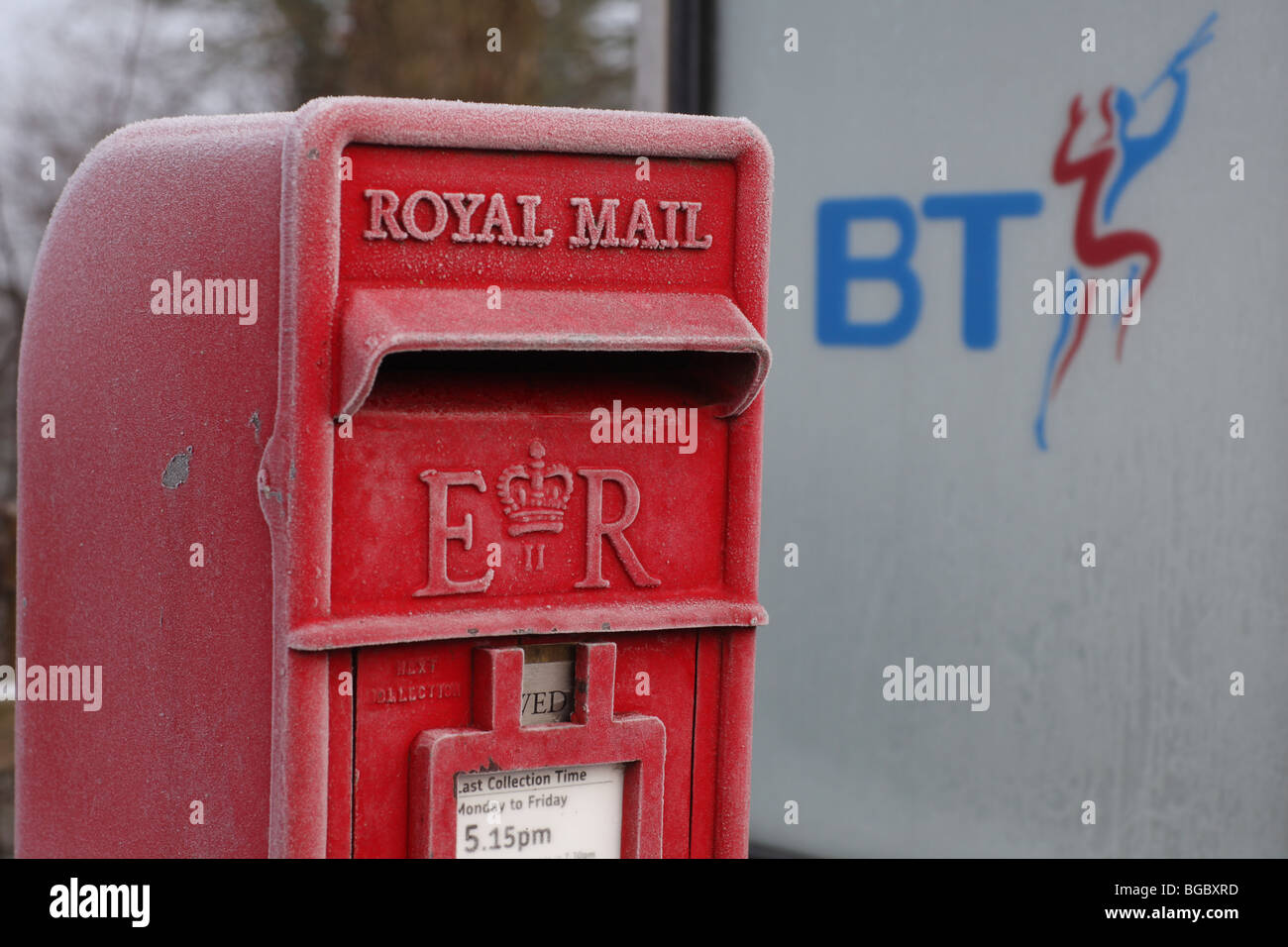 A Royal Mail post box and a BT telephone kiosk in the UK - Stock Image