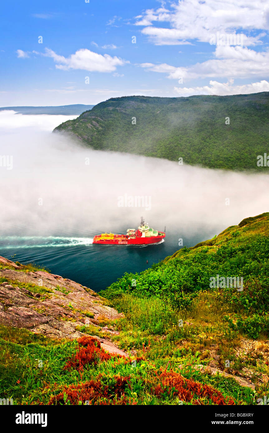 Ship entering the Narrows of St John's harbor from Signal Hill in Newfoundland Canada Stock Photo