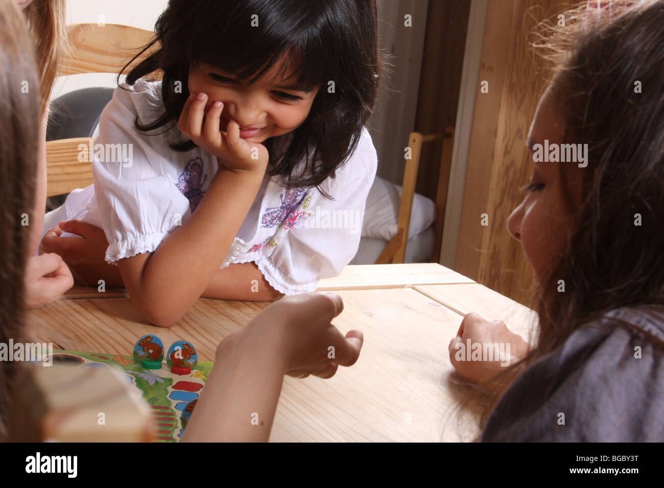 Children playing a board game. - Stock Image