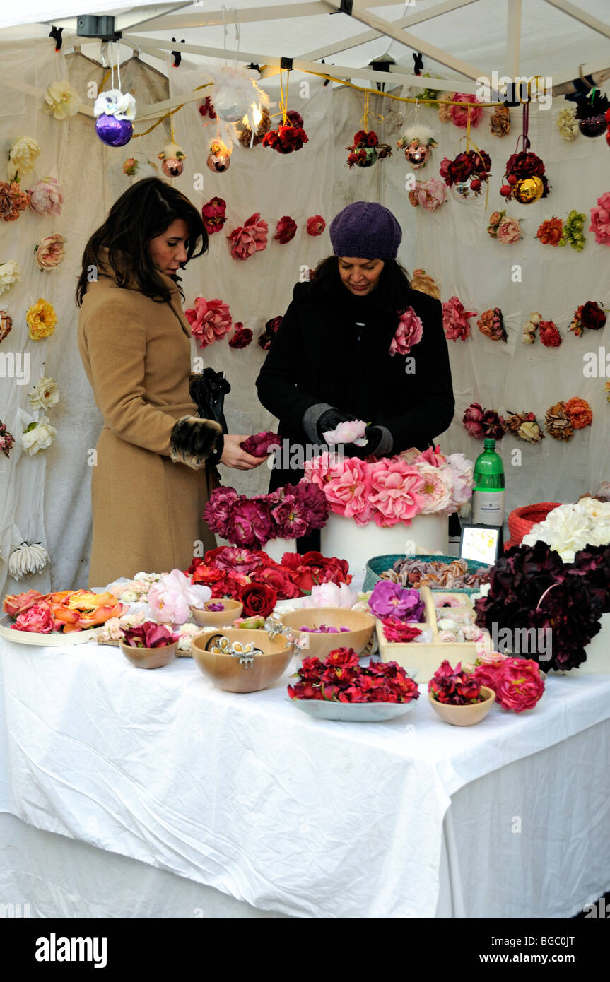 Lady Buying Silk Flowers At Cabbages And Frocks Market Marylebone