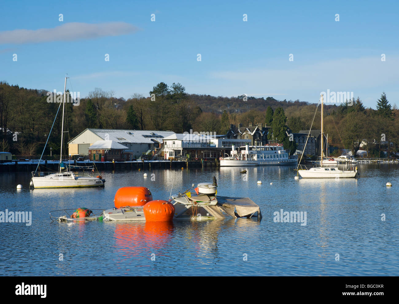 Flotation devices attached to half-sunk boat, Lakeside, Lake Windermere, Lake District National Park, Cumbria, England - Stock Image