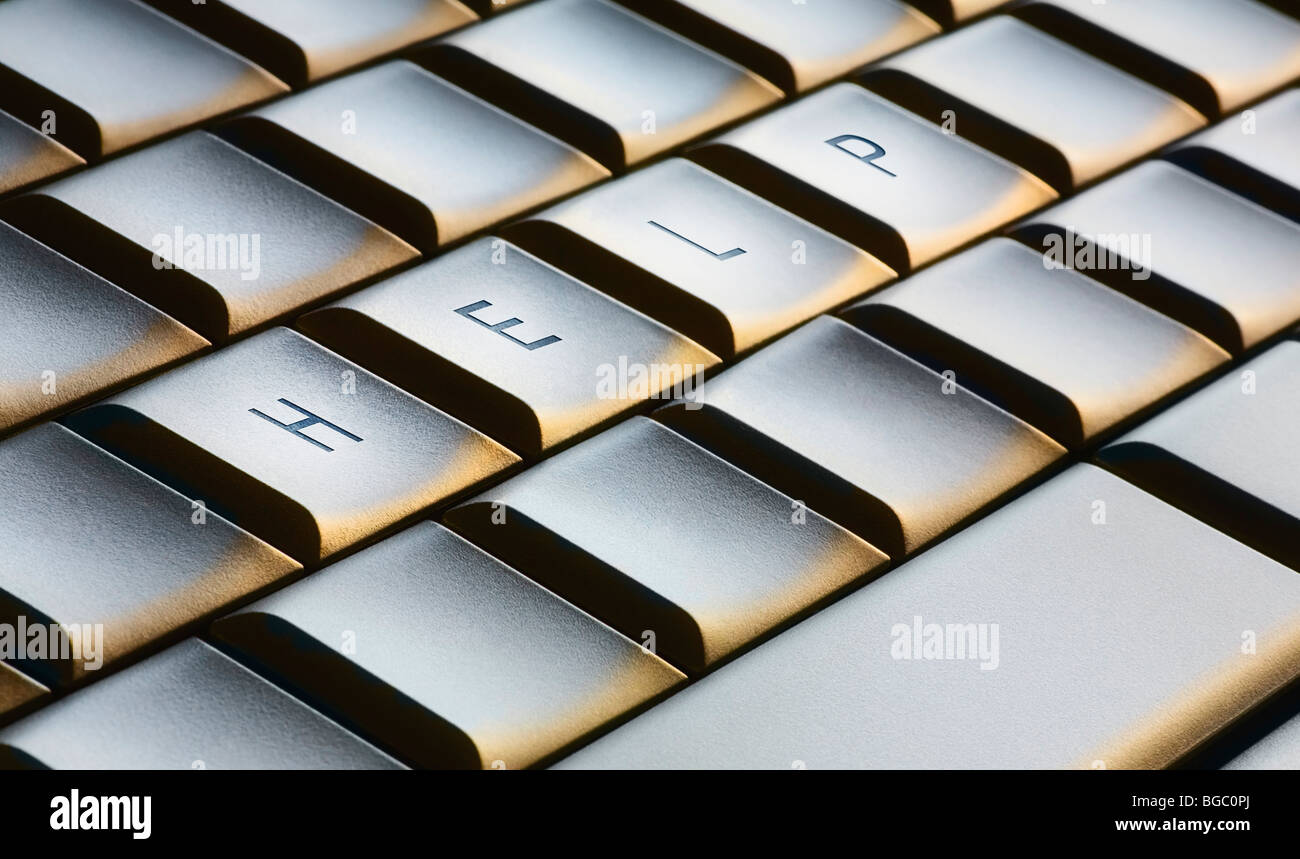 Computer support concept with 'help' spelled out on keyboard - Stock Image