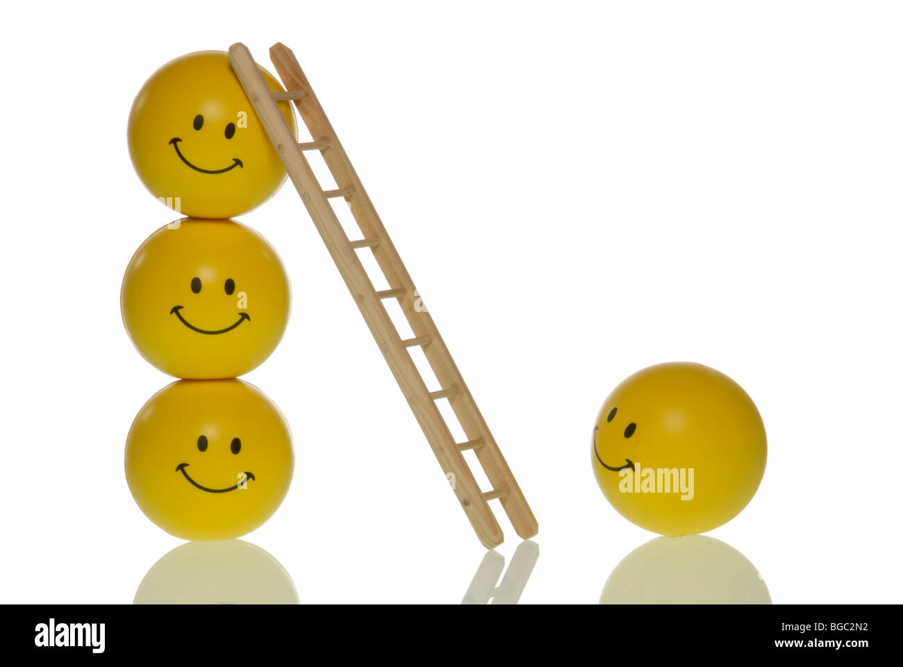 Smiley has the chance to rise to the top, symbolic image for success ladder - Stock Image