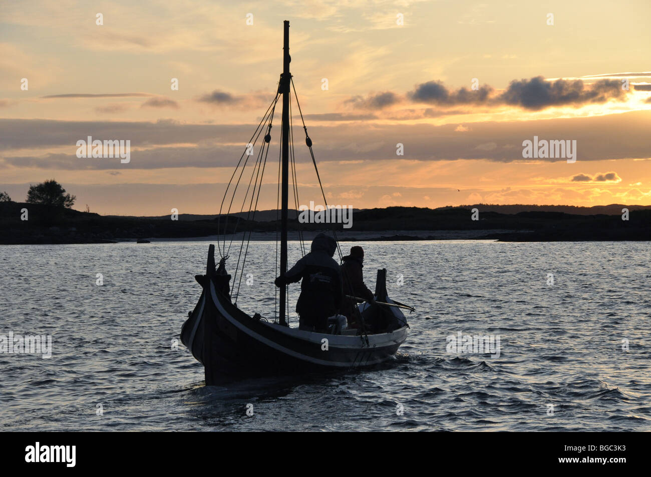 A trip by the light of the midnight sun at Kjerringoy  Handelssted  Salten  Nordland Norway - Stock Image