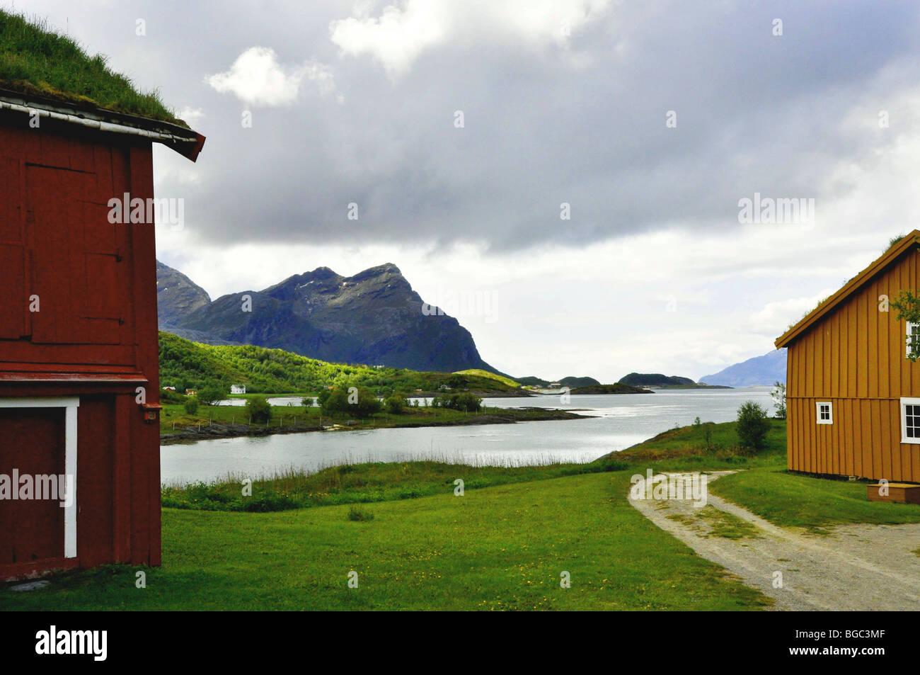 Characteristic wooden buildings and landscape at Kjerringoy  Handelssted  Salten  Nordland Norway - Stock Image