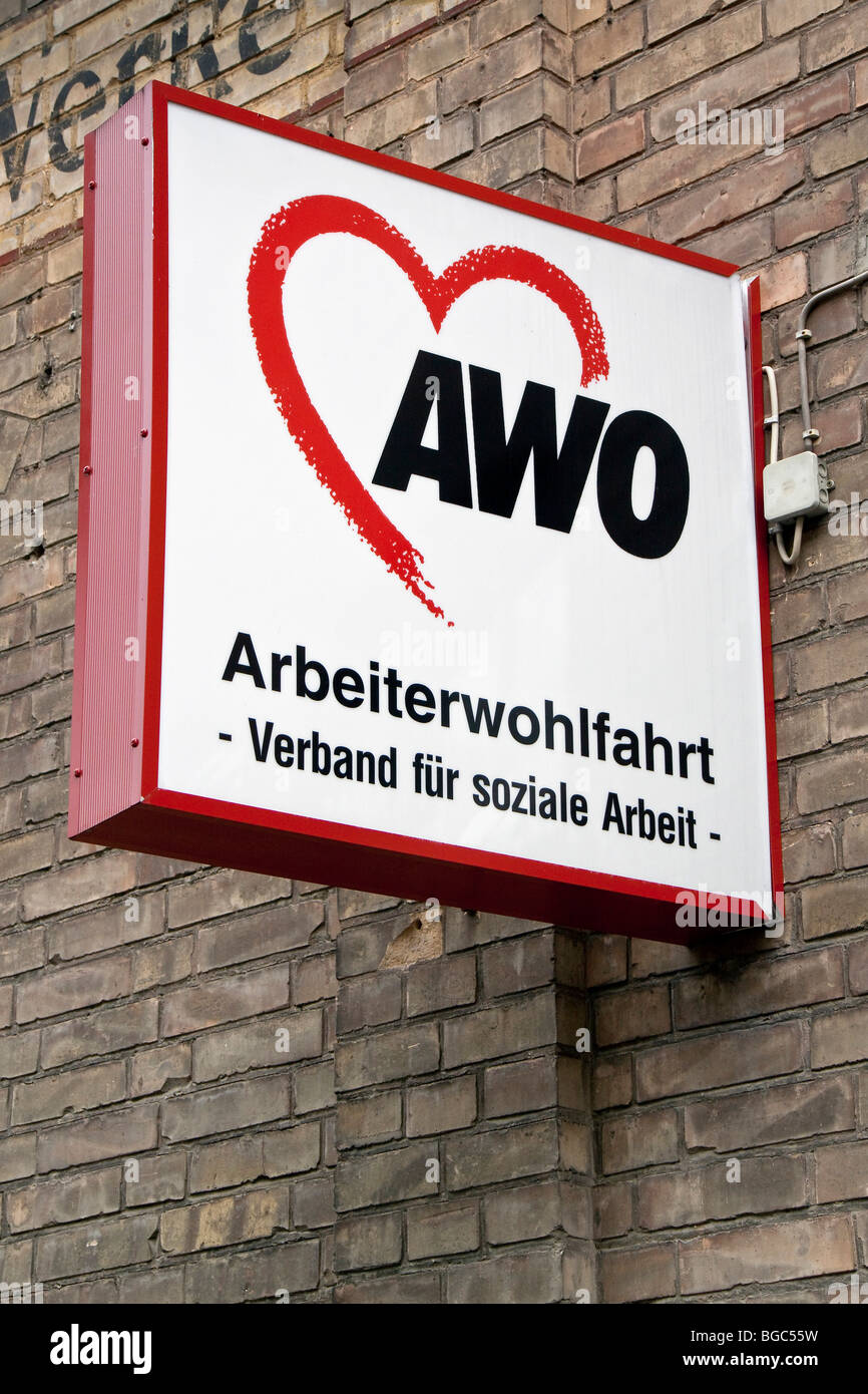 A sign with the logo of the Arbeiterwohlfahrt, German Workers' Welfare Association - Stock Image