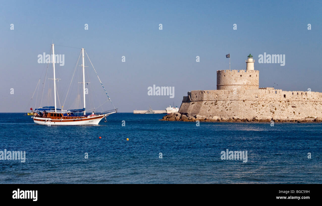 Harbor entrance and harbor fortress of Agios Nikolaos, Rhodes town, Rhodes island, northern part of Greece, Aegean - Stock Image