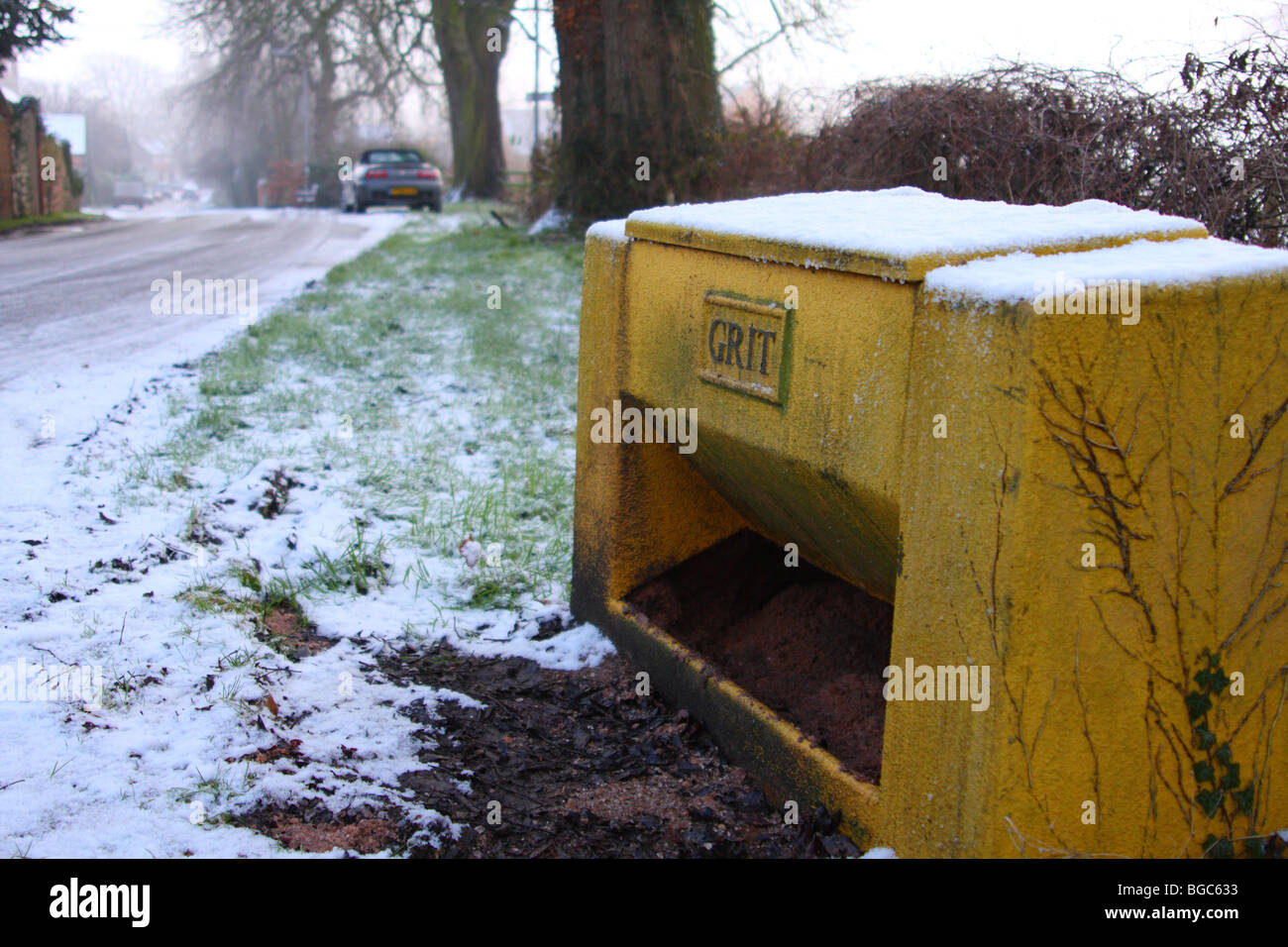 A roadside grit bin on a road in the U.K. - Stock Image