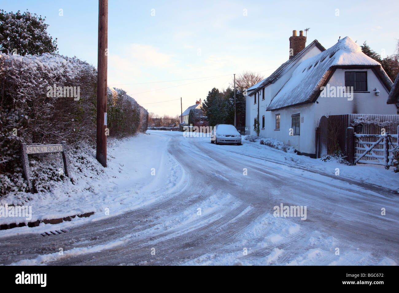 Snow covered road junction Great Gransden Cambridgeshire - Stock Image