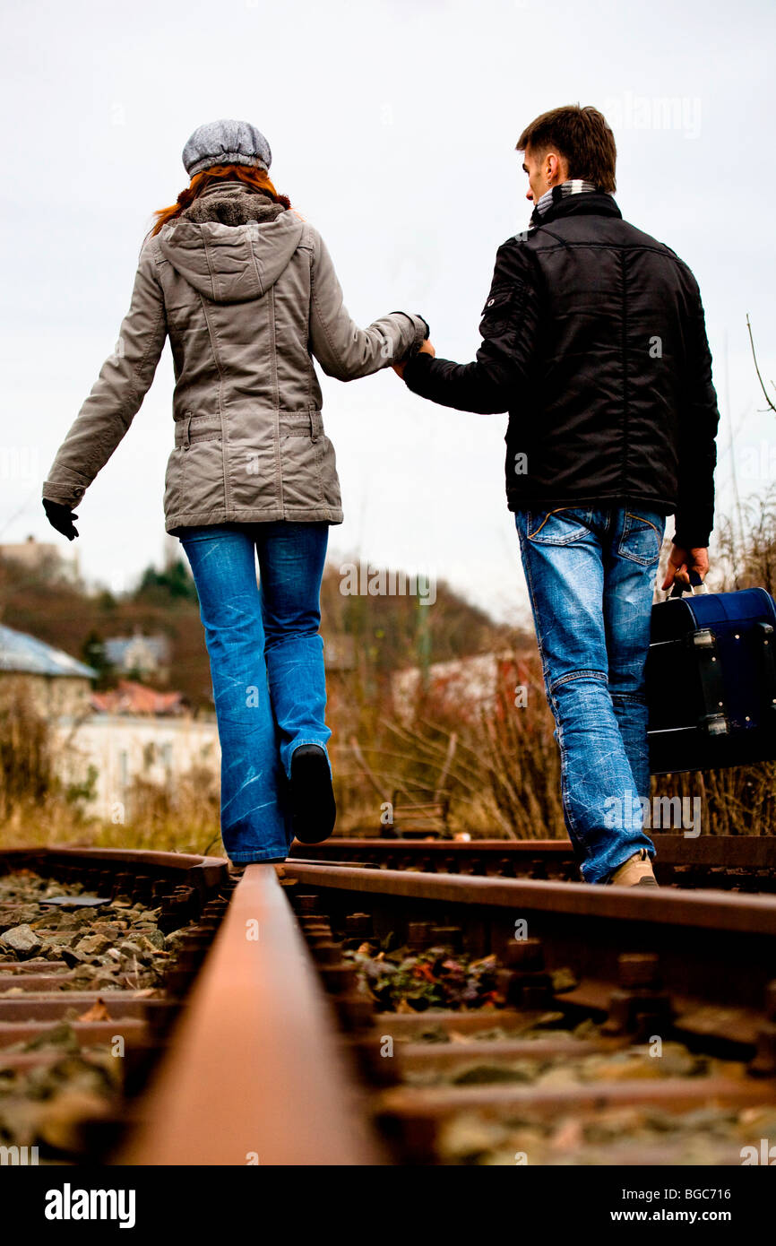 Couple on rail track Stock Photo