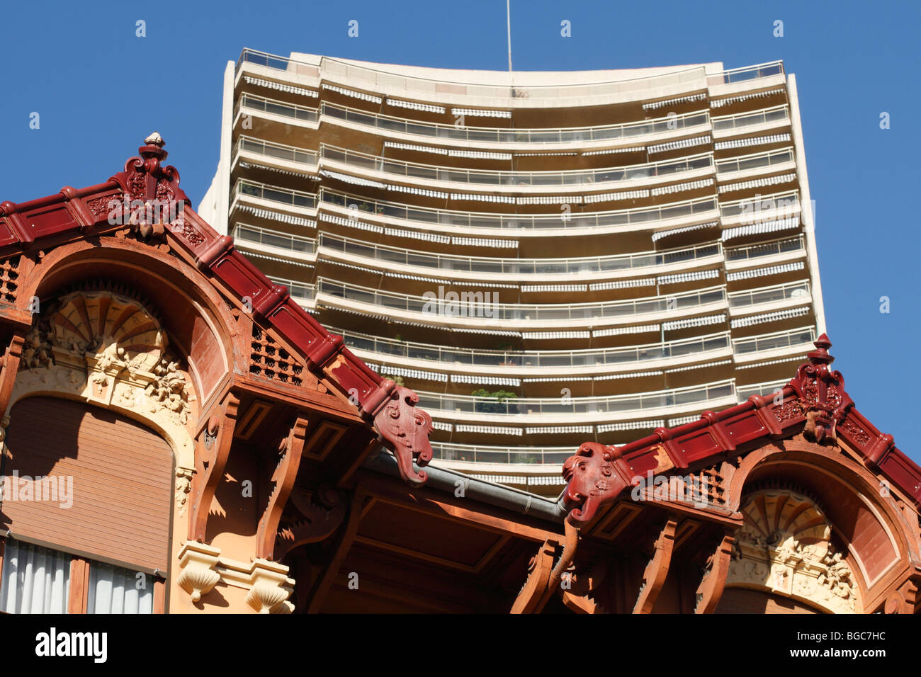 Gable of an old house in front of a skyscraper, Boulevard d'Italie, Monaco, Cote d'Azur, Europe - Stock Image