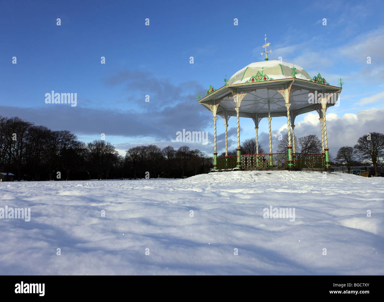 The Victorian traditional bandstand in Duthie Park in Aberdeen, Scotland, UK, seen in the snow in winter Stock Photo