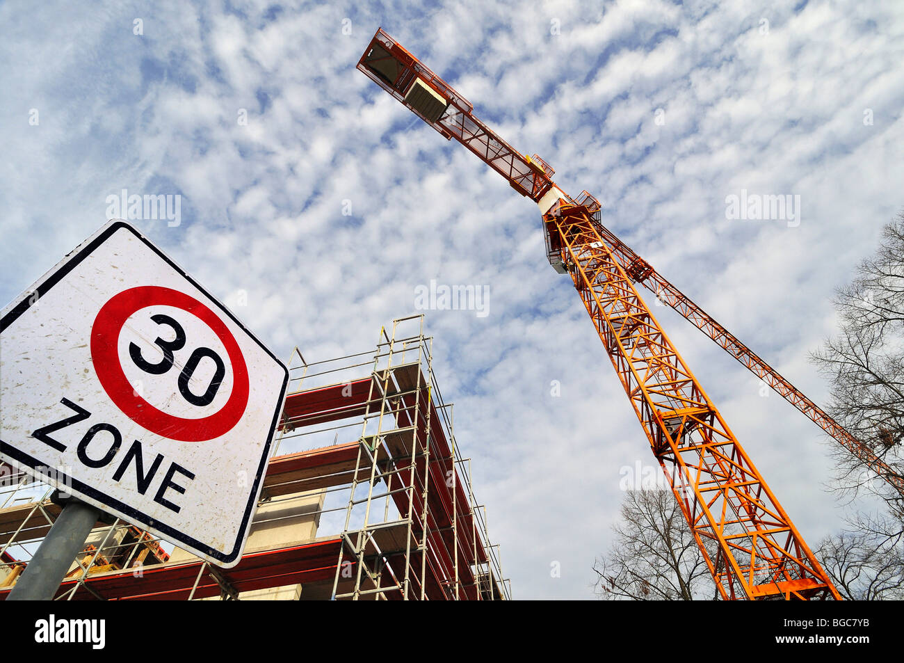 Building under construction with scaffolding, crane and 30-zone sign, Munich, Bavaria, Germany, Europe - Stock Image