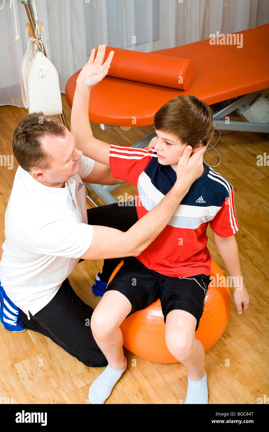 Physiotherapist and patient doing physiotherapy - Stock Image