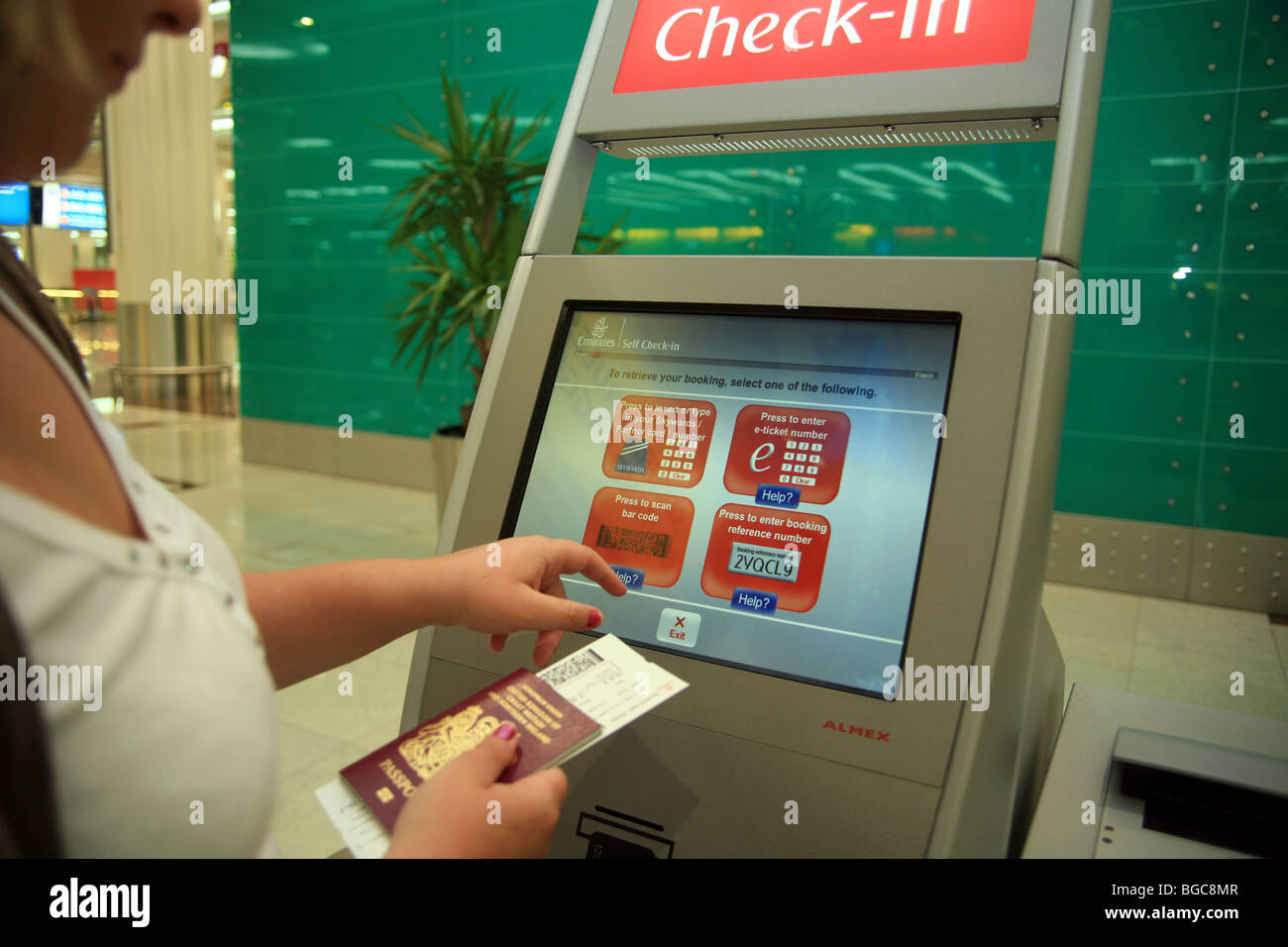 Self-check in and using a passport scanner at Dubai Airport